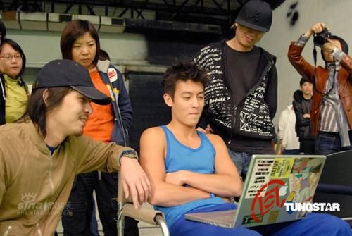Edison Chen showing off his photo collection