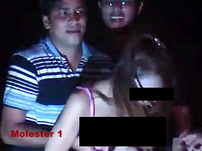 Exposed: The molesters at Siloso Beach Countdown Party 2009