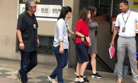New Natalie Siow Yu Zhen photo shows her back at the Orchard Towers murder crime scene in prison garb