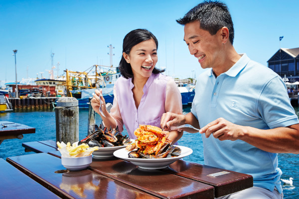 Tuck into fresh seafood right by the sea in Fremantle Fishing Boat Harbour.