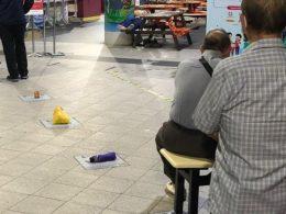 Singaporeans level up chope-ing with umbrellas in Sengkang CC queue - Alvinology