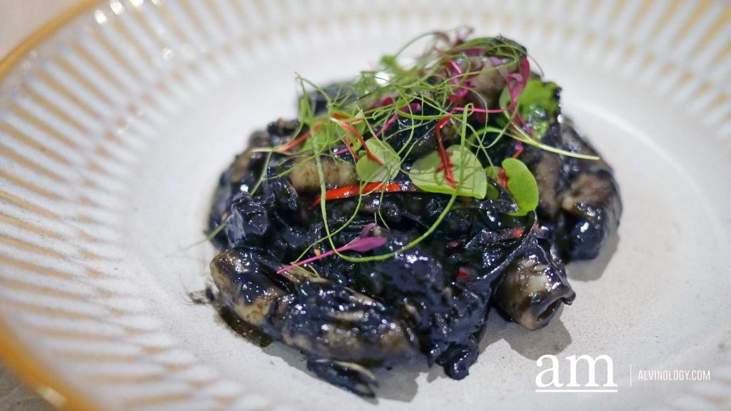 Sotong Masak Hitam, wok-fried squid with squid ink, shrimp paste and concentrated tamarind juices - $20